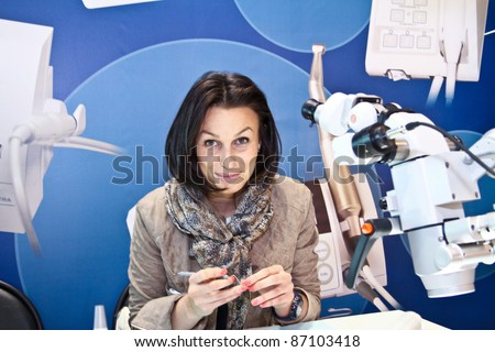 MOSCOW - APRIL 27: Female working as dental technician at the international exhibition of the dental professionals and industry on April 27, 2011 in Moscow