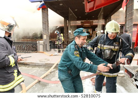 MOSCOW - APRIL 30: Firefighters extinguishing fire at the Viking floating restaurant on the Berezhkovskaya embankment, April 30, 2010 in Moscow, Russia.