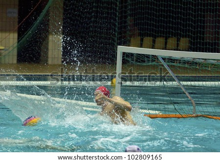 MOSCOW - APRIL  6: Galimzyanov Anvar, goaltender of Sintez(Kazan) team during a game Dynamo(white) vs Sintez (green) of waterpolo Championship of Russia on April 6, 2012 Moscow,Russia.Sintez won 13:10 - stock photo