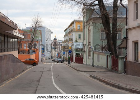 MOSCOW - APRIL 4: Homes and cars in Podkopaevsky Street on April 4, 2016 in Moscow. Podkopaevsky Street is located in the center of Moscow.