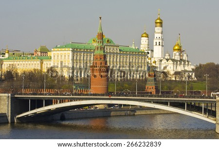 MOSCOW - APRIL 20, 2014: Kremlin fortress with Big Kremlin palace, bell tower of Ivan the Great, Arhangelskiy cathedral and Big Stone brige on Moscow-river.  - stock photo