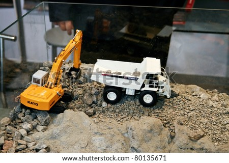 MOSCOW - APRIL 13: Large earth moving heavy equipment at the international exhibition of  the Mining and Processing of Metals and Minerals, MiningWorld on April 13, 2011 in Moscow - stock photo