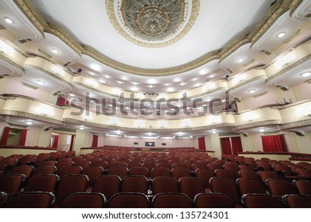 MOSCOW - APRIL 23: Lighting auditorium in Vakhtangov Theatre on April 23, 2012 in Moscow, Russia. Vakhtangov Theater is located in historical center of Moscow, on Old Arbat. - stock photo