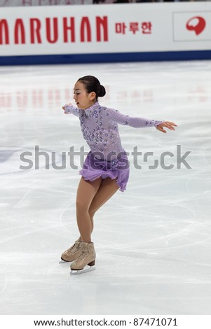 """MOSCOW - APRIL 30: Mao Asada competes in the single ladies free figure skating event at the 2011 World championship on April 30, 2011 at the Palace of sports """"Megasport"""" in Moscow, Russia. - stock photo"""