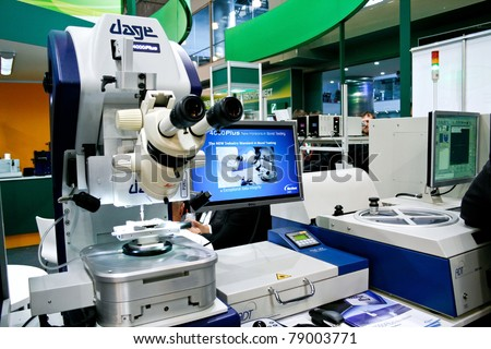 MOSCOW - APRIL 19: Microscope used in electronics at the international exhibition of  electronic industry ExpoElectronica, ElectronTechExpo, LEDTechExpo on April 19, 2011 in Moscow - stock photo