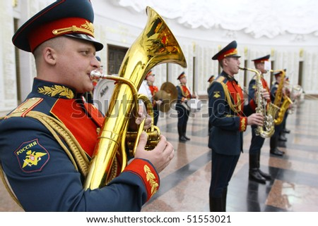 MOSCOW - APRIL 21: Military orchestra on ceremony of transfer of the symbolic Victory Banner of the delegation of the Republic of Kazakhstan in the Hall of Fame, April 21, 2010 in Moscow, Russia. - stock photo