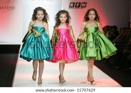 MOSCOW - APRIL 4: Models walk the runway during the Aljokhina Collection as part of Russian Fashion Week April 4, 2007 in Moscow, Russia. - stock photo