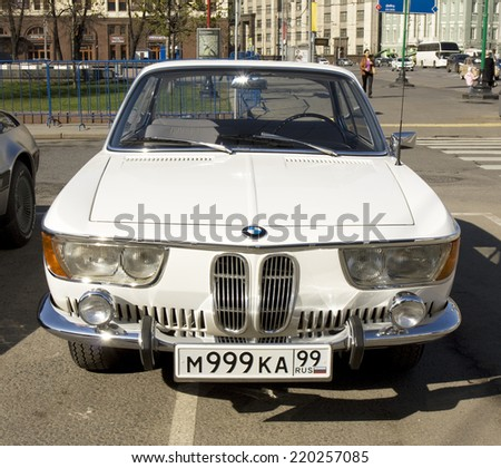 MOSCOW -?? APRIL 27, 2014: retro car BMW of 1966 year on rally of classical cars, organized by Russian Club of Classical Autocars on Theatre square.  - stock photo