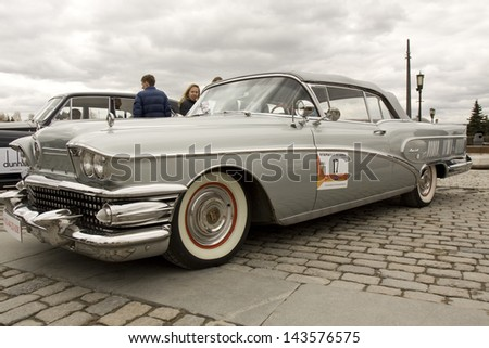 MOSCOW - APRIL 21: retro car cadillac on rally of classical cars on Poklonnaya hill,  April 21, 2013, in town Moscow, Russia.  - stock photo