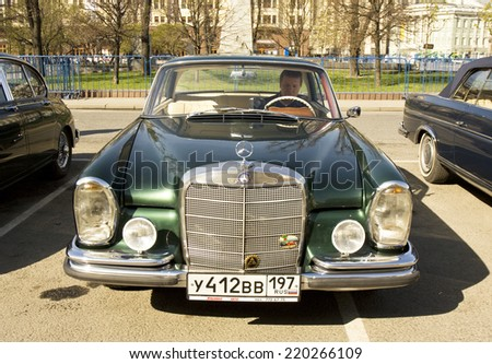 MOSCOW - APRIL 27, 2014: retro car mercedes benz of 1964 on rally of classical cars, organized by Russian Club of Classical Autocars on Theatre square.  - stock photo
