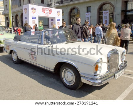 MOSCOW - APRIL 27, 2014: retro car mercedes benz of 1962 year on rally of classical cars, organized by Russian Club of Classical Autocars on Theatre square.  - stock photo
