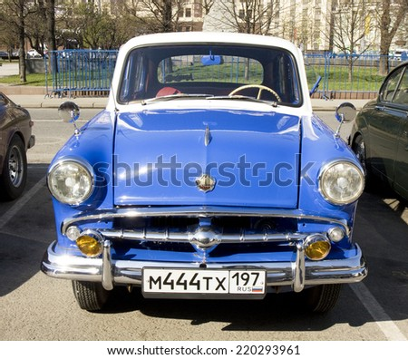MOSCOW - APRIL 27, 2014: Russian retro car Moskvich on rally of classical cars, organized by Russian Club of Classical Autocars on Theatre square.  - stock photo