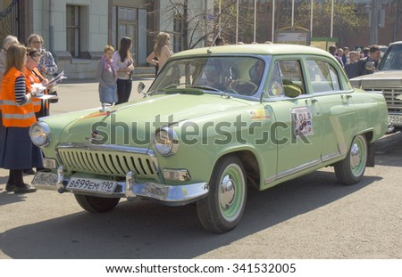 MOSCOW - APRIL 27, 2014: Russian retro car Volga GAZ of 1962 year on rally of classical cars, organized by Russian Club of Classical Autocars on Theatre square.