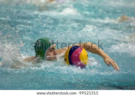 MOSCOW - APRIL  6: Shepelev Roman during a game Dynamo(white) vs Sintez (green) of waterpolo Championship of Russia on April 6, 2012 Moscow, Russia. Sintez won 11:10 - stock photo