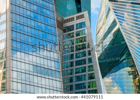 MOSCOW- APRIL 25, 2016: Steel and glass corporate buildings reflect the sky and clouds, Moscow - stock photo
