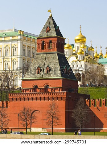MOSCOW - APRIL 20, 2014: Tayninskaya tower of fortress Moscow Kremlin and Annunciation cathedral, built in 15 century. - stock photo