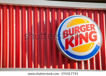 """MOSCOW - APRIL 29: The logo of the fast food chain """"Burger King"""", April 29, 2014, Moscow, Russia. Burger King is a global chain of hamburger fast food restaurants - stock photo"""