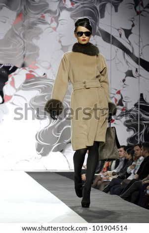 MOSCOW - APRIL 5: The model walks a runway in a collection of Igor Gulyaev, autumn-winter 2012/13 Volvo Fashion Week April 5, 2012 in Moscow, Russia