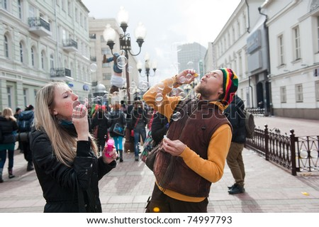 "MOSCOW - APRIL 10: Unidentified people having fun on the holiday of spring and bubbles ""Dreamflash"" on April 10, 2011 on the famous pedestrian Arbat Street in Moscow"