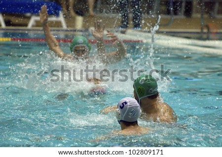 MOSCOW - APRIL  6: Unidentified player during a game Dynamo(white) vs Sintez (green) of waterpolo Championship of Russia on April 6, 2012 Moscow, Russia. Sintez won 13:10 - stock photo