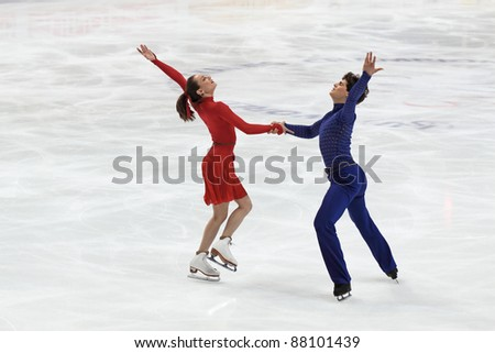 "MOSCOW - APRIL 30:  Vanessa Crone and Paul Poirier compete in the pair ice dance at the 2011 World championship figure skating event at the Palace of sports ""Megasport"" on April 30, 2011 in Moscow, Russia. - stock photo"