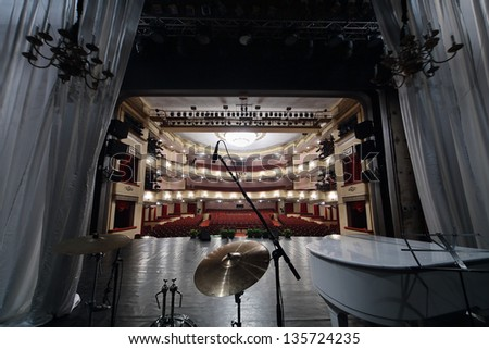 MOSCOW - APRIL 23: View from behind wing flats at auditorium in Vakhtangov Theatre on April 23, 2012 in Moscow, Russia. Auditorium of Large stage of theater accommodates 1055 people. - stock photo