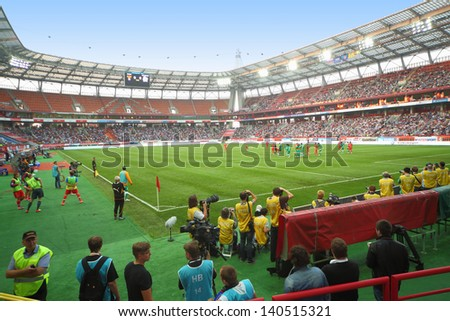 MOSCOW - AUG 15: Warm-up before the match between Russia national team and Ivory Coast at Lokomotiv Stadium on August 15, 2012 in Moscow, Russia. The game ended with the score 1:1 - stock photo