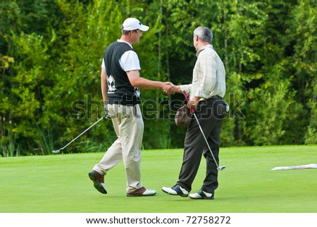 MOSCOW - AUGUST 8: A group unidentified golfers shake hands at the annual VI Moscow Festival Retrostyle event for fans and professionals at the Le Meridien Moscow County Club on August 8, 2008 in Moscow, Russia - stock photo