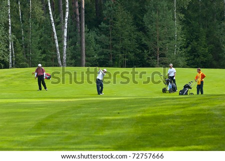 MOSCOW - AUGUST 8: An group of unidentified golfers compete at the annual VI Moscow Festival Retrostyle event for fans and professionals at the Le Meridien Moscow County Club on August 8, 2008 in Moscow, Russia - stock photo