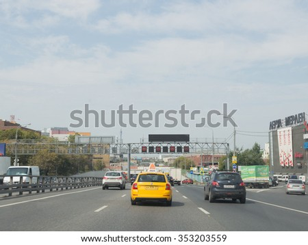 Moscow - August 13, 2015: Cars and yellow taxi driving on the Third Ring Road in the summer of August 13, 2015, Moscow, Russia - stock photo