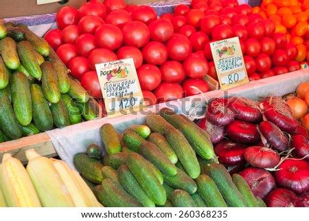 MOSCOW - AUGUST 08: Cucumbers, tomatoes, onions at Vegetable Fair counter on Leskov Street on August 8, 2014 in Moscow. - stock photo