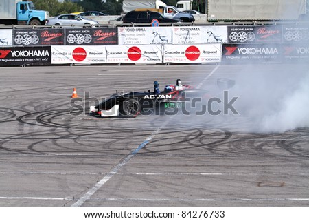 MOSCOW - AUGUST 25: Drift show formula 1 auto at the international exhibition of  the auto and components industry, Interauto on August 25, 2011 in Moscow - stock photo