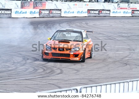 MOSCOW - AUGUST 25: Drift show Orange team at the international exhibition of  the auto and components industry, Interauto on August 25, 2011 in Moscow