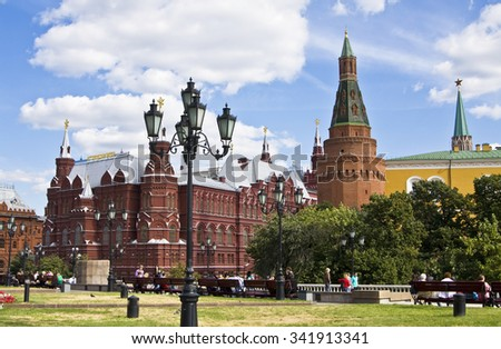 MOSCOW - AUGUST 21, 2010: Historical museum on Manezhnaya square, has been built in 1883, and tower of fortress Moscow Kremlin. - stock photo