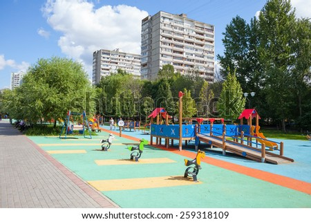 MOSCOW - AUGUST 2: Playground and residential buildings in Heritage Village Park in Bibirevo district on August 2, 2013 in Moscow. Bibirevo is district of North-Eastern part of Moscow, Russia. - stock photo