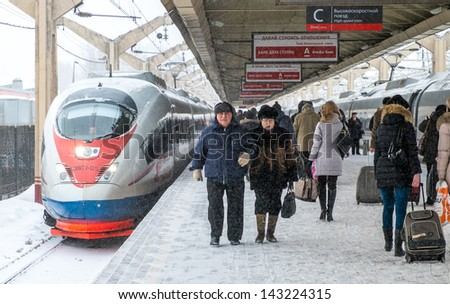 MOSCOW - CIRCA MARCH 2013: Passengers in the Leningradsky Railway Station circa March 2013. With a population of more than 11 million people is one the largest cities in the world. - stock photo