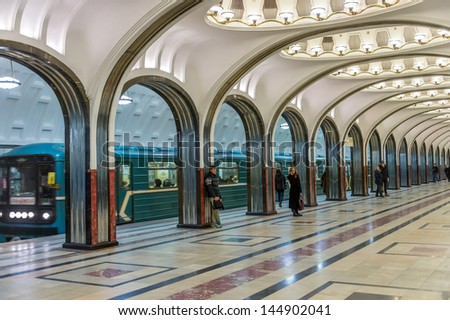 MOSCOW - CIRCA MARCH 2013: People in Mayakovskaya Metro Station circa March 2013. With a population of more than 11 million people is one the largest cities in the world and a popular destination. - stock photo