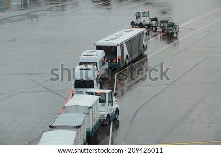 MOSCOW - CIRCA SEPTEMBER 2013: Vehicles of various airport services awaits for passage in Domodedovo Int., Moscow, Sept. 2013. Because of the high airfield activity, sometimes are happen traffic jams. - stock photo