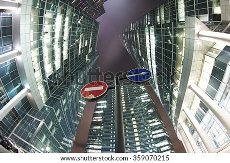 Moscow-city business center at night with road signs - stock photo