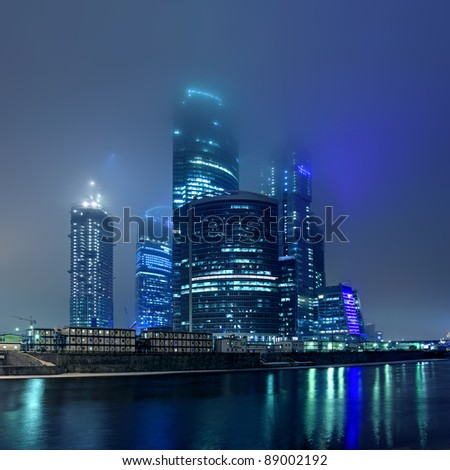 Moscow City in myst at night - stock photo
