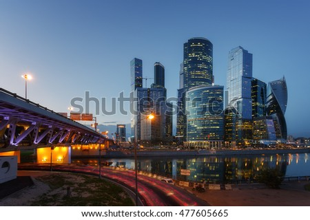Moscow City (Moscow International Business Center), river, bridge and cars. Cityscape