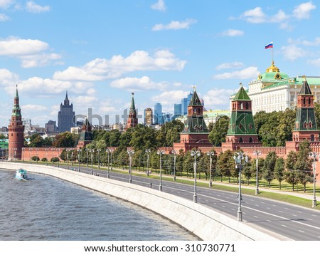 Moscow cityscape - view of Red Walls and Towers of Moscow Kremlin on Kremlin Embankment of Moskva Rive in Moscow, Russia in summer day - stock photo