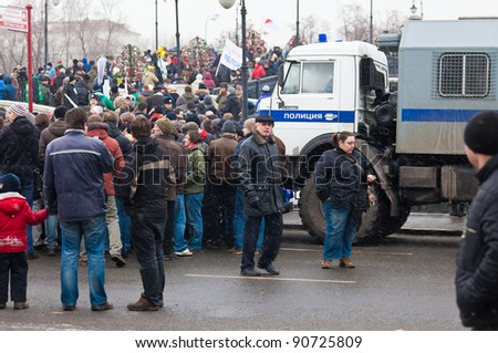 MOSCOW - DEC 10: Mass protest against parliamentary elections in Russia at Bolotnaya square. Biggest protest in Russia for the last 20 years, December 10, 2011 in Moscow, Russia. - stock photo
