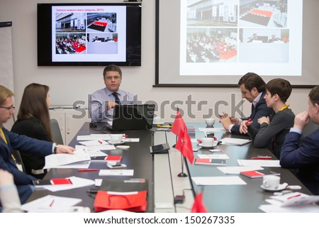 MOSCOW - DEC 20: People at the table discussing on Business Breakfast at the office Rosbank on December 20, 2012 in Moscow Russia. - stock photo