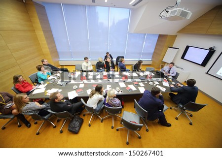 MOSCOW - DEC 20: People in the conference room on Business Breakfast at the office Rosbank on December 20, 2012 in Moscow Russia. - stock photo