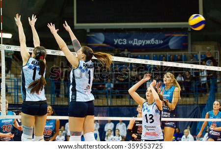 MOSCOW - DECEMBER 2: A. Del Cora (15) and M. Borodakova (1) defence on a game Dynamo MSK vs Dynamo KZN on Russian National women Volleyball tournament on December 2, in Moscow, Russia, 2015 - stock photo