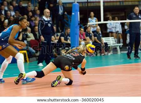 MOSCOW - DECEMBER 2: Anna Malova (3) take a ball on a game Dynamo MSK vs Dynamo KZN on Russian National women Volleyball tournament on December 2, in Moscow, Russia, 2015 - stock photo