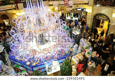 MOSCOW - DECEMBER 21: Christmas fair, illumination and buyers in GUM store on December 21, 2014 in Moscow. - stock photo