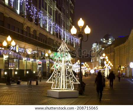 MOSCOW - DECEMBER 29, 2013: Christmas illumination on Old Arbat street in city cdntre, electric Christmas trees. - stock photo