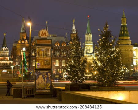MOSCOW - DECEMBER 26, 2013: Christmas trees near towers of Kremlin fortress and Historical museum on Manezhnaya square. - stock photo